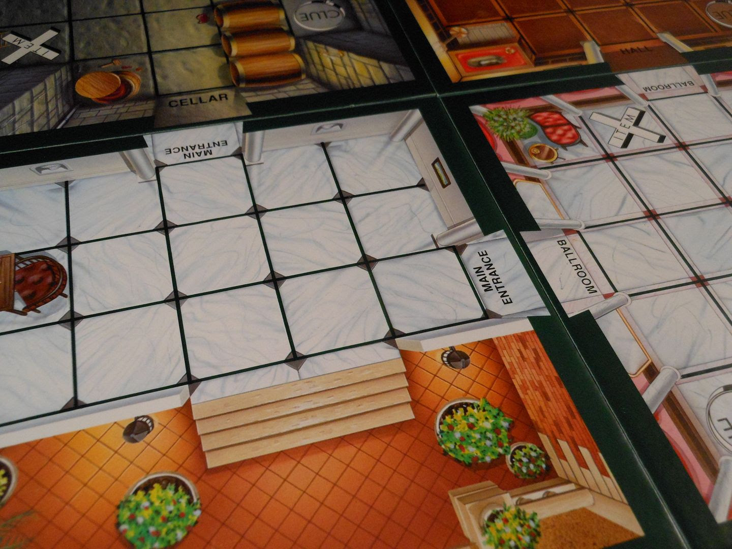 An arrangement of colourful board tiles from Cluedo Super Sleuth.