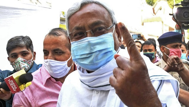 Bihar chief minister Nitish Kumar shows his finger marked with indelible ink after casting his vote during the second phase of Bihar Assembly Election in Patna. AP
