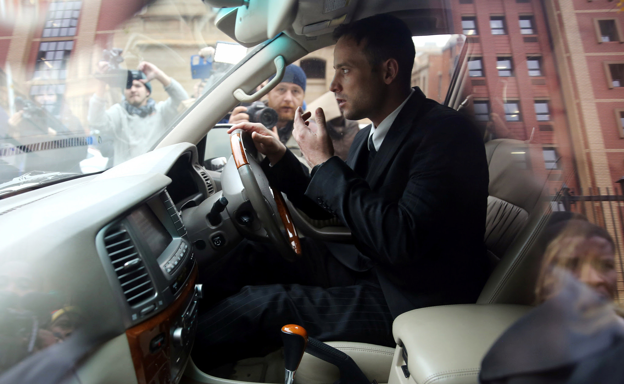 Former Paralympian Oscar Pistorius leaves after the second day of his sentencing for the murder of his girlfriend Reeva Steenkamp, at Pretoria High Court, South Africa