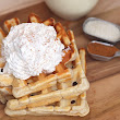 Eggnog Waffles with Sweet Cinnamon Whipped Cream - Over The Big Moon