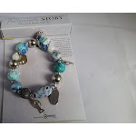 Roman 173709 Bracelet Footprints Bead & Charm Stretch with Prayer Card