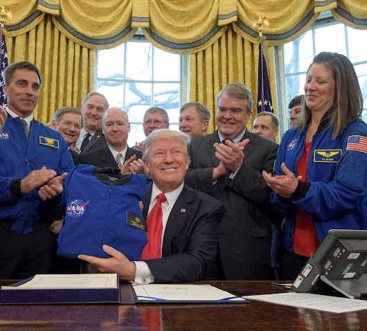 Trump signs legislation setting NASA's agenda; Pence will chair space council