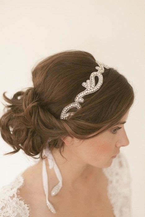 Beautiful soft low bun..maybe with a smaller head band