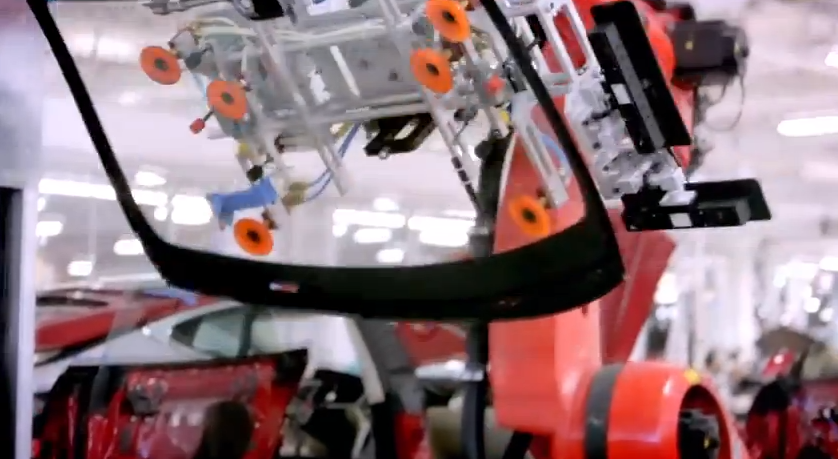 The same robot that installs the seats is able to pick up a windshield, put glue on it, and attach it to the car in a matter of seconds.