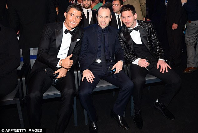 Three's company: Ronaldo (left) and Messi (right), separated by Andres Iniesta