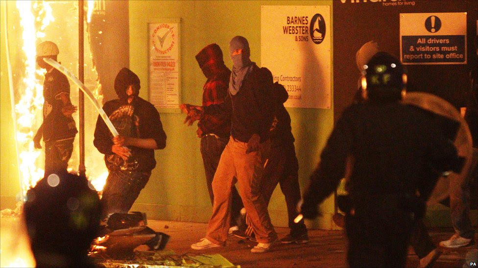 Rioters and police in Tottenham, north London