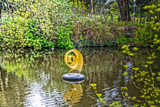 UNFURLING SCULPTURE BY ANNE McGILL [FLOATING ON THE LAKE AT FARMLEIGH]