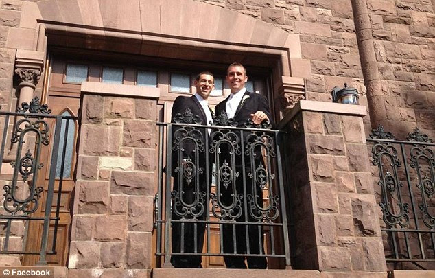 Newlyweds: Darren Manzella and Javier Lapeira together on their wedding day last month