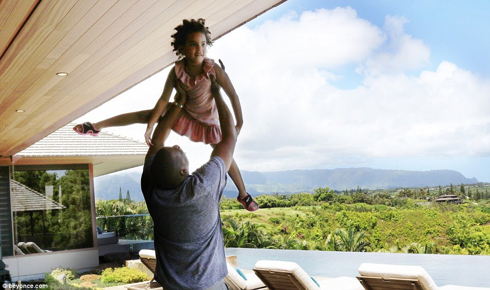 Lift off! Jay Z, 46, looked every inch the doting dad as he lifted his little girl above his head in Hawaii, where the famous family are taking a break