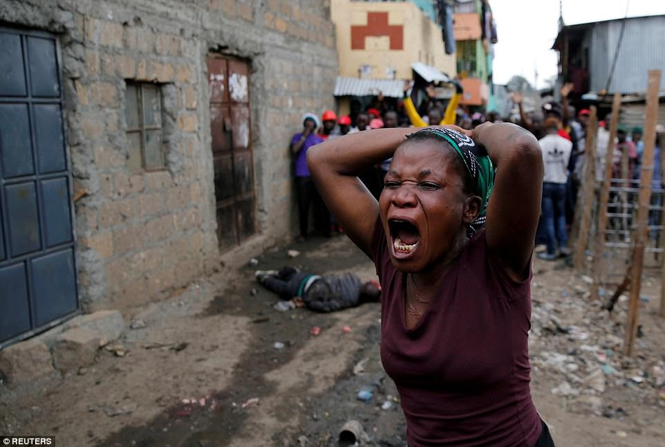 A crying woman mourns the death of a protester in Mathare, Nairobi, Kenya on August 9. The protests followed the re-election ofPresident Uhuru Kenyatta