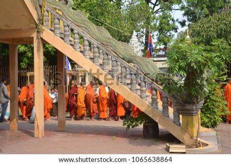 Phnom Penh, Cambodia – February 01, 2018: The queue of Buddhist Monks. A distance view from under the stairs.
