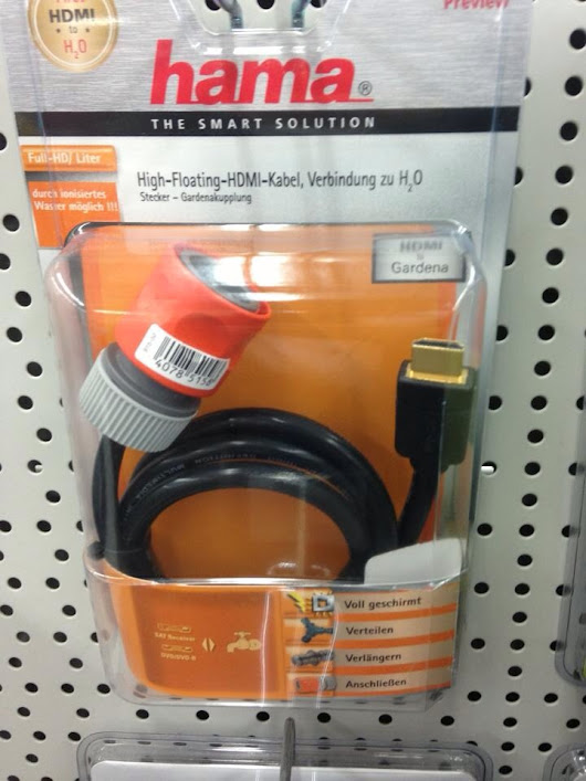 Walking through my local electronic store I found this ... HDMI to garden hose - you know for the next time I want to water my graphic card (found in Speyer, Germany) - Imgur