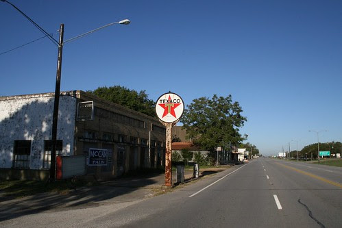 looking down highway at wallis texaco
