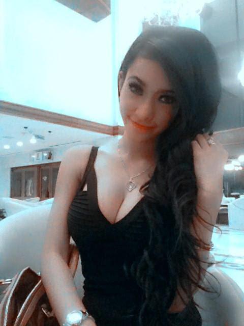 Amel Alvi in Black Dress