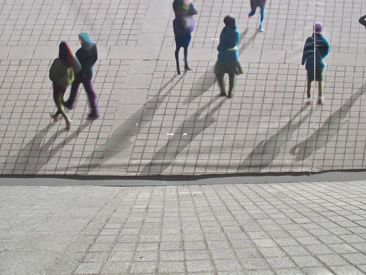 Pedestrians on scaffolding