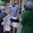 Magician Scares People By Playing a Panhandler With a Third Arm