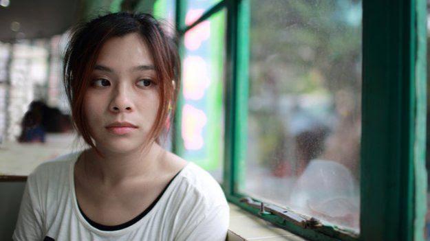 Young sad Japanese woman