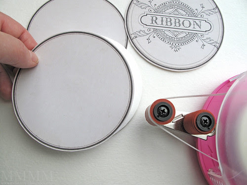 Step 7) Flip the front label circle (that you just cut out) over and adhere the back onto it