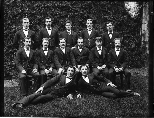 Group photograph of 13 young men in dark suits by Powerhouse Museum Collection