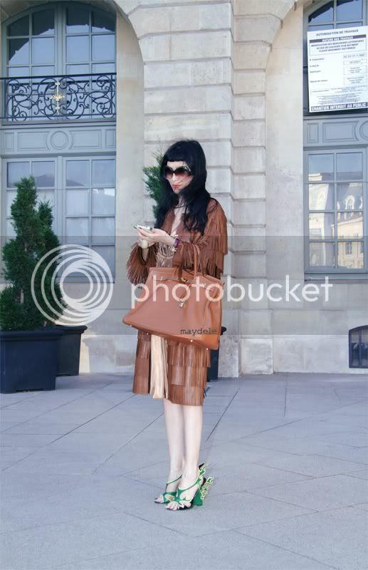 Designer Zhor Tiber from Zhor&Néma wearing Prada spring summer 2012 coat and shoes, Lanvin dress and Hermès Birkin tote bag