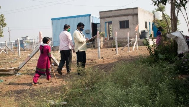 Frontline healthcare workers in Tardal village surveying the community and helping people register on CoWIN