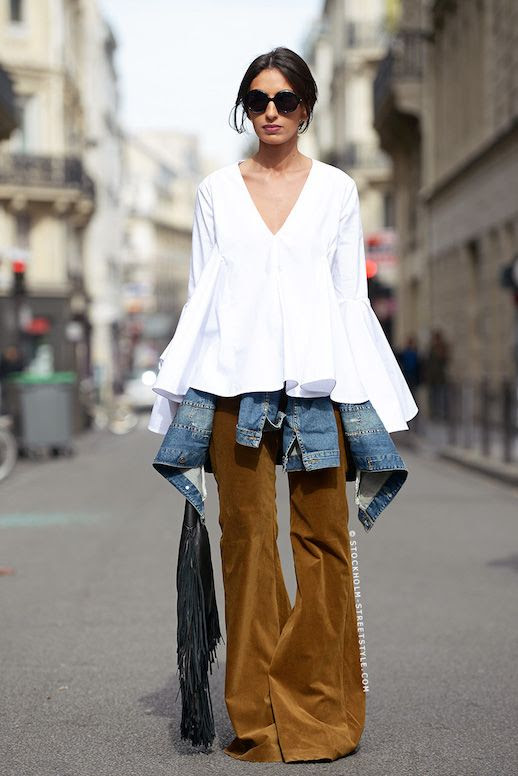 Le Fashion Blog Layers Street Style Black Round Sunglasses White Top With Flared Waist And Sleeves Denim Jacket Brown Bell Suede Pants Fringed Bag Via Carolines Mode