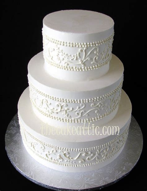 White on white piped scroll work wedding cake by