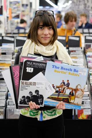 Lesley Cooper, 32, from Mexico, poses an armful of vinyl, her choice cuts being The Beach Boys' Surfin' Safari, a 7