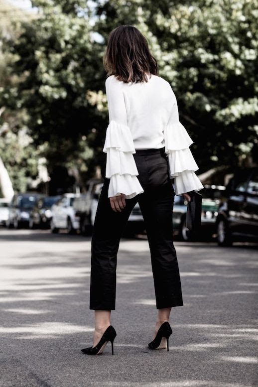 Le Fashion Blog Fashion Blogger Ruffle White Sleeve-Black Trousers Black Pumps Via Harper And Harley