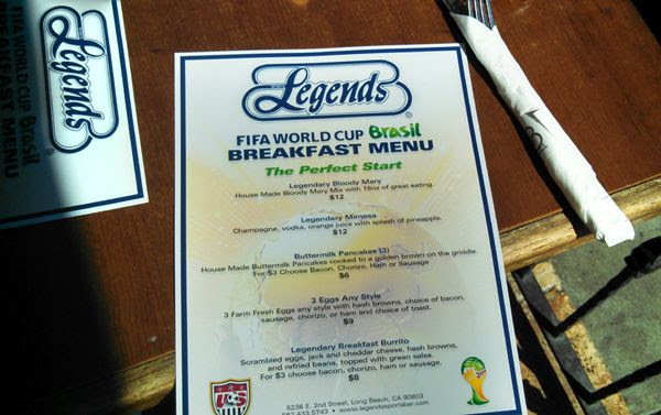 Grabbing a bite to eat at the Legends sports bar in Long Beach, CA, before the start of the World Cup final game in Brazil...on July 13, 2014.