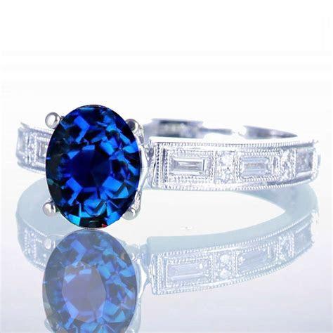 1.5 Carat Oval Cut Sapphire and Baguette Diamond Milgrain