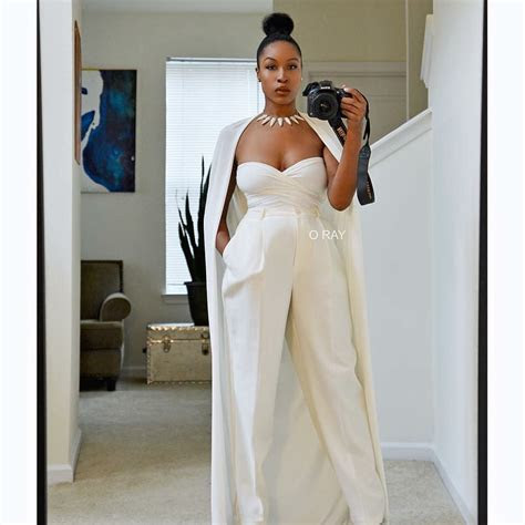 tailored  white bridal jumpsuit  cape fierce