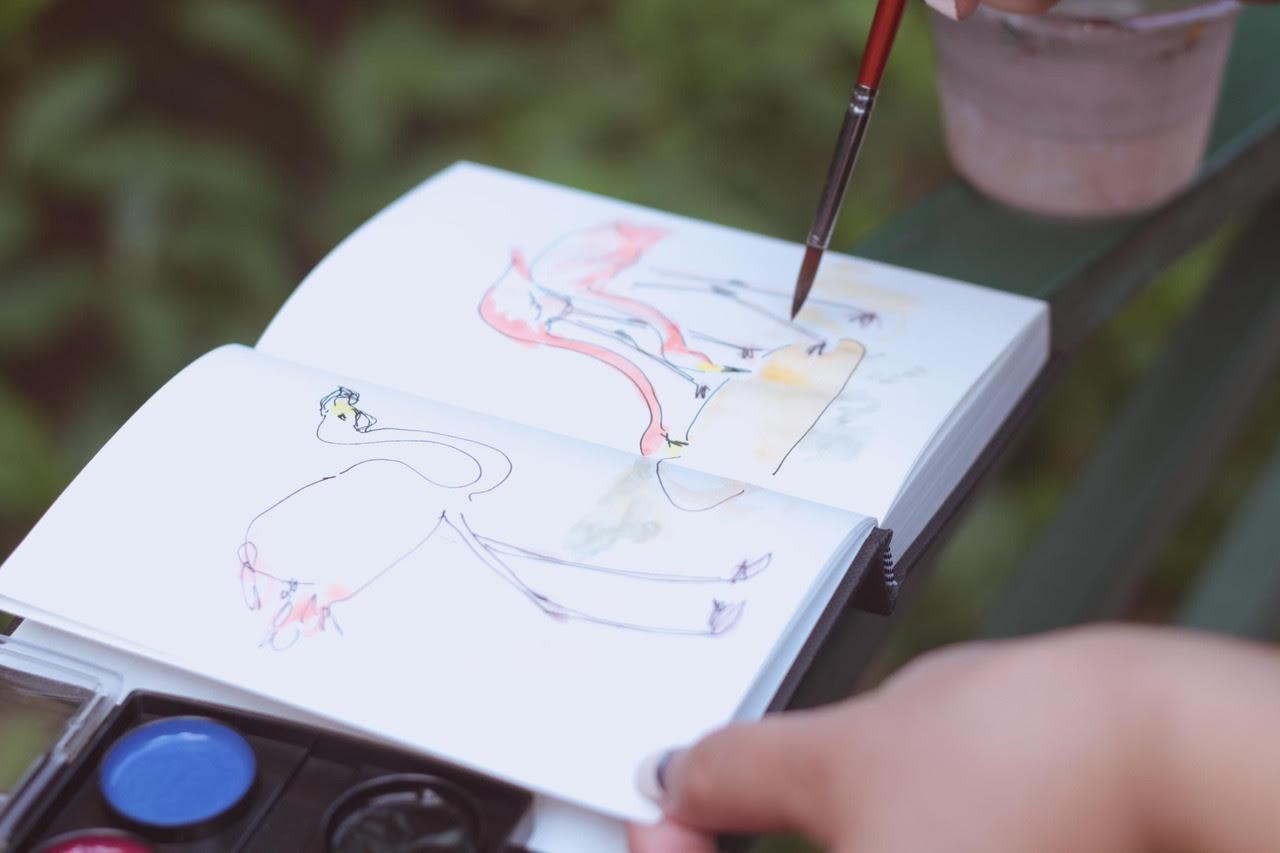 sketching flamingos drinking water gouache