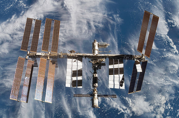 The Space Station floats above Earth in a photograph taken from the Atlantis shuttle orbiter in February.