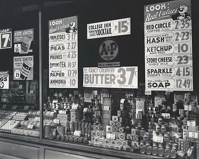 A & P (Great Atlantic & Pacific Tea Co.), 246 Third Avenue, Manhattan. Window display showing can goods, eggs, crackers, etc. and signs for sale items, ads with Kate Smith inviting you to try 2 different coffees.
