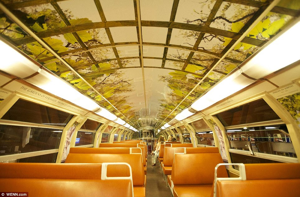 Enormous: Branches sprawl across the ceiling of the carriage in this huge painting