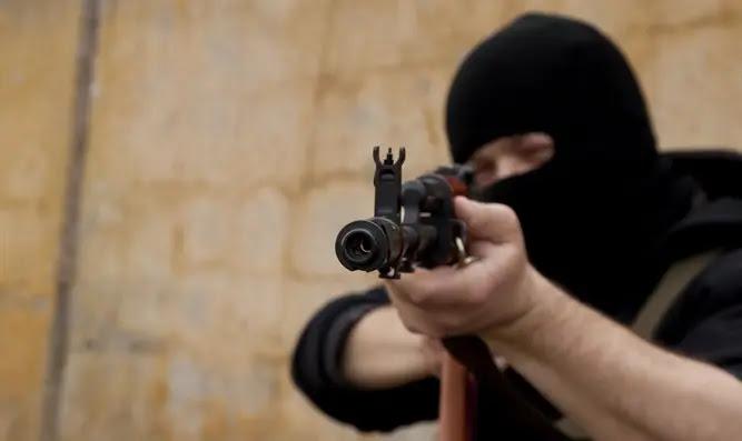 Terrorist shooting gun