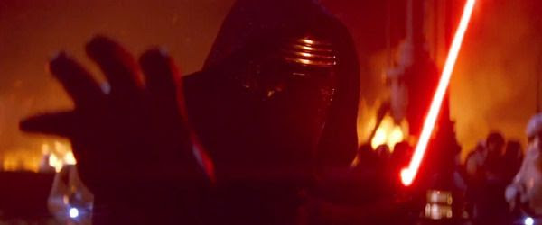 As Jakku villagers and Stormtroopers of The First Order look on, Kylo Ren uses the Force on a hapless individual in STAR WARS: THE FORCE AWAKENS.