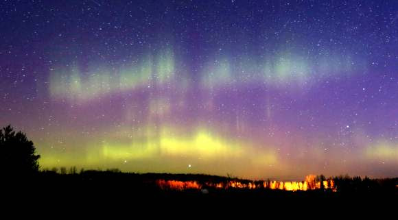 Curtains of aurora still pushed through the growing light of dawn. Credit: Bob King