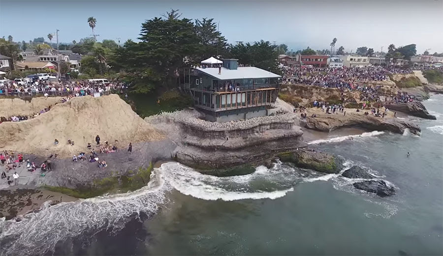 The crowd that showed up to watch the paddle out is estimated to be around 5,000 people.
