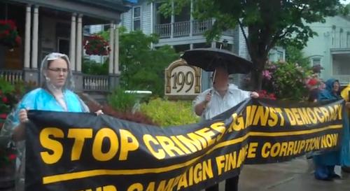 Members rally outside Senator Farley's office