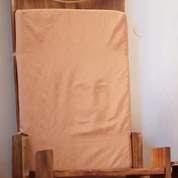 Les fidèles ont vu dans les plis de ce coussin le visage du Christ. Crédit photo : AFP.
