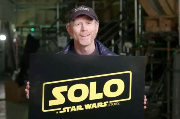 Director Ron Howard holds up a card announcing that the Han Solo spin-off film will be titled SOLO: A STAR WARS STORY.