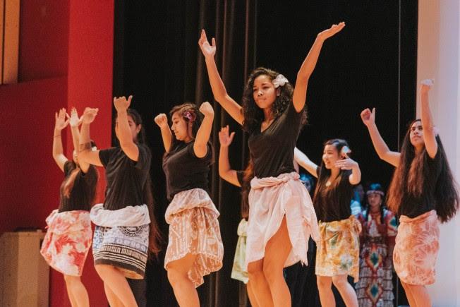 Pacific Islanders dancing. They are from Fiji, Hawai'i, Philippines, Samoa, Tahiti, Thailand, and Tonga.