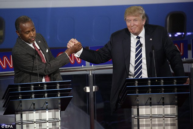 At the debate, Ben Carson (left) and Donald Trump (right) mostly played nice, but Trump previously questioned Carson's record on abortion calling it 'horrendous'