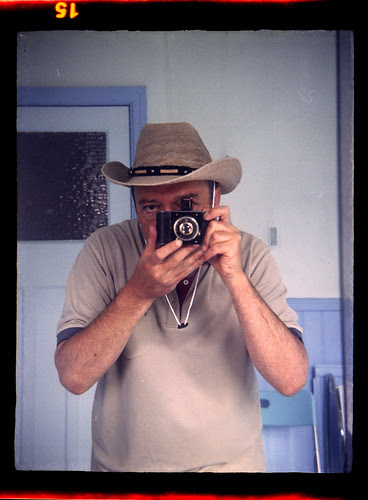reflected self-portrait with Korelle camera and cowboy hat from Poundland by pho-Tony