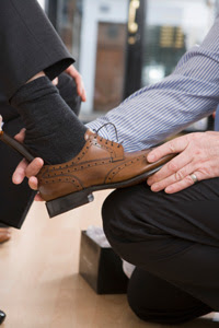 Photo: Man trying on shoes