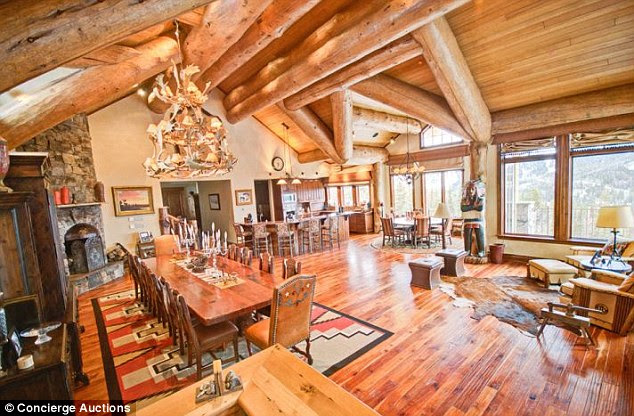 Polished look: An open living area decked in ancient logs and cherry hardwood floors feature a family room, bar, gourmet kitchen, breakfast and dining spaces