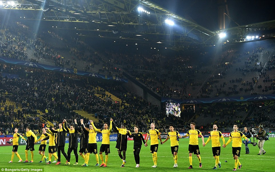The Borussia Dortmund players salute the Yellow Wall following a record-breaking evening at the Westfalenstadion
