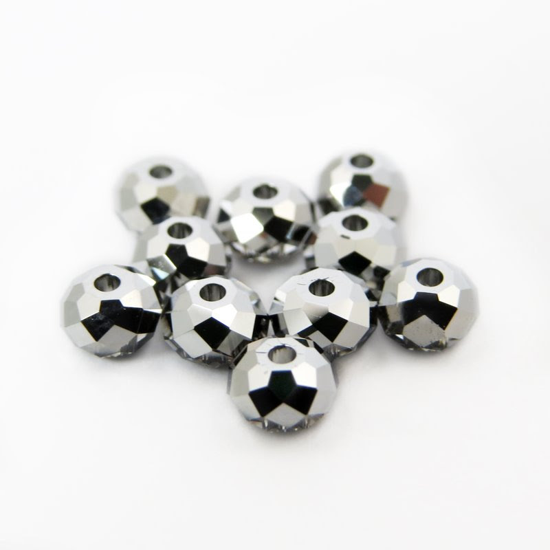 s46037 Swarovski Bead - 4 mm Faceted Donut (5040) - Crystal Light Chrome (1)